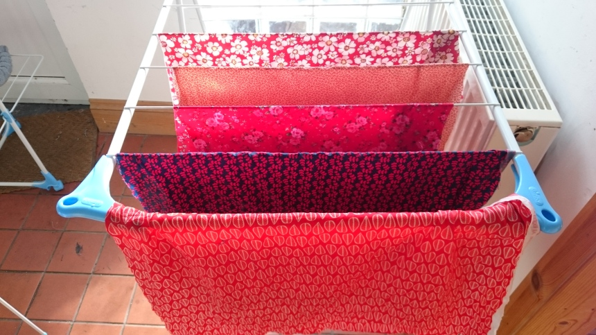 Hanging red fabrics out to dry.JPG
