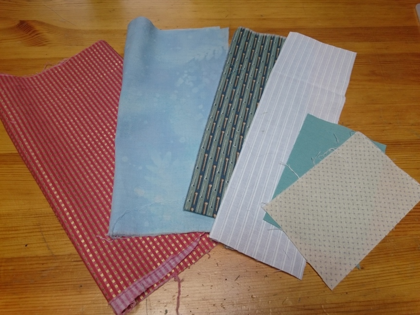 Fabrics for Happy House block.JPG